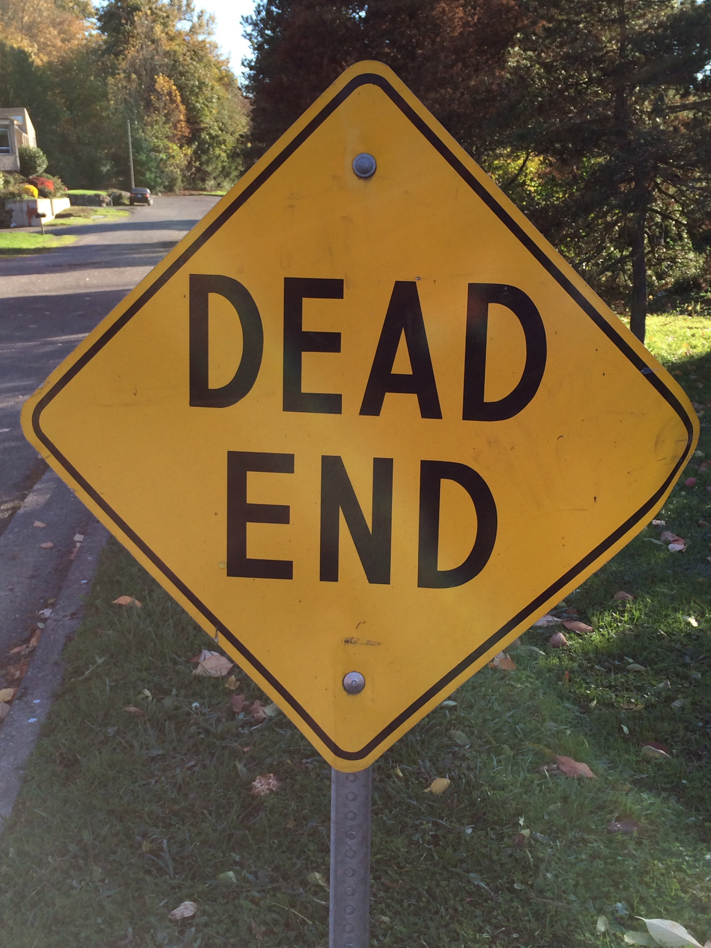 life coach page emily downward dead end street sign